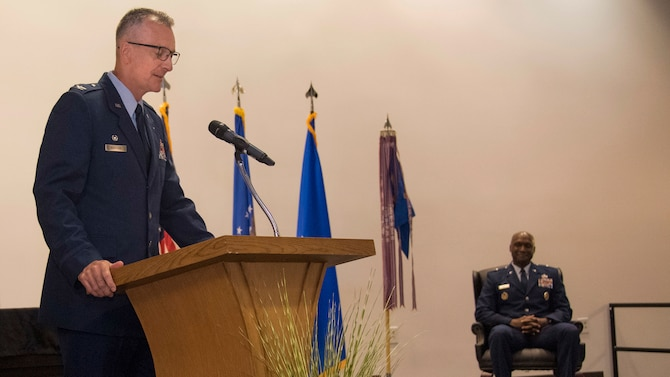 Col. Terry Koester speaks during 982nd TRG change of command