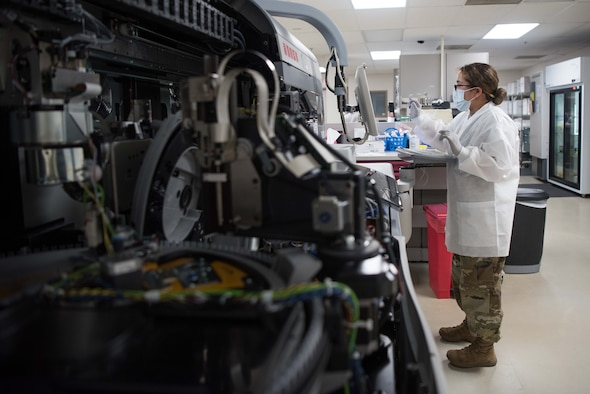 Staff Sgt. Maria Sibert, 22nd Medical Support Squadron lab technician, cleans a chemistry analyzer July 20, 2020, at McConnell Air Force Base, Kansas. The chemistry analyzer tests plasma samples for abnormalities such as high or low cholesterol, electrolytes, thyroid hormones and diabetes. (U.S. Air Force photo by Senior Airman Alexi Bosarge)