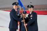 Col. Mark Robinson, 12th Flying Training Wing commander passes the guidon to Col. Robert Moschella, 12th Operations Group commander at Joint Base San Antonio-Randolph July 24. Prior to assuming command Moschella was the Division Chief of Air Combat Command's Test and Training Division at Joint Base Langley-Eustis, Virginia. (U.S. Air Force Photo by Sean Worrell)