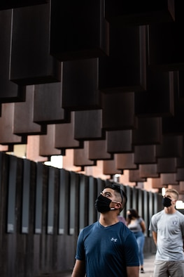An Air Force Reserve Officer Training Corps cadet training assistant walks through The National Memorial for Peace and Justice.