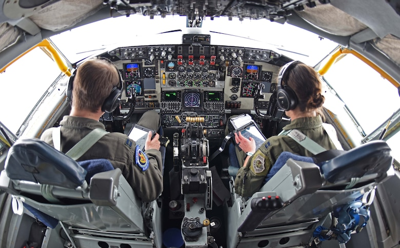 Captains Nicholas Boonstra, 351st Air Refueling Squadron pilot, left, and Marissa Hartoin, 351st ARS aircraft commander, review in-flight checklists over Scotland, July, 23, 2020. The 351st ARS, as part of the 100th Air Refueling Wing, conducts air refueling and combat support operations throughout the European and African area of responsibility. (U.S. Air Force photo by Senior Airman Brandon Esau)