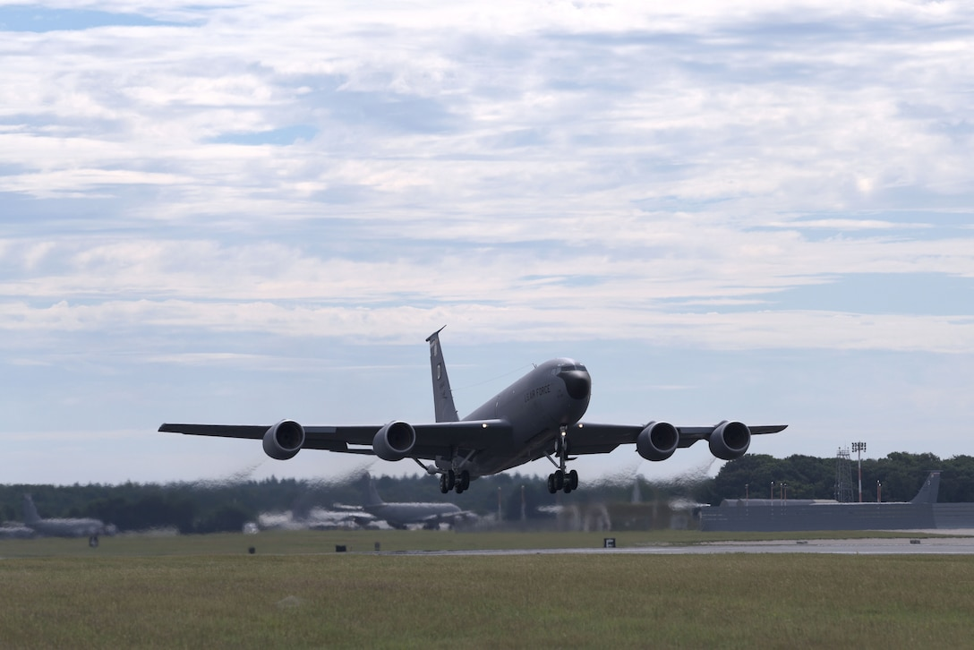 "A U.S. Air Force KC-135 Stratotanker, assigned to the 100th Air Refueling Wing, takes off at RAF Mildenahall, July 23, 2020. The 100th ARW is the only permanent U.S. air refueling wing in the European theater, providing the critical air refueling ""bridge"" which allows the Expeditionary Air Force to deploy around the globe at a moment's notice. (U.S. Air Force photo by Senior Airman Benjamin Cooper)"