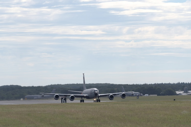 """A U.S. Air Force KC-135 Stratotanker, assigned to the 100th Air Refueling Wing, taxis across the runway for takeoff at RAF Mildenahall, July 23, 2020. The 100th ARW is the only permanent U.S. air refueling wing in the European theater, providing the critical air refueling """"bridge"""" which allows the Expeditionary Air Force to deploy around the globe at a moment's notice. (U.S. Air Force photo by Senior Airman Benjamin Cooper)"""