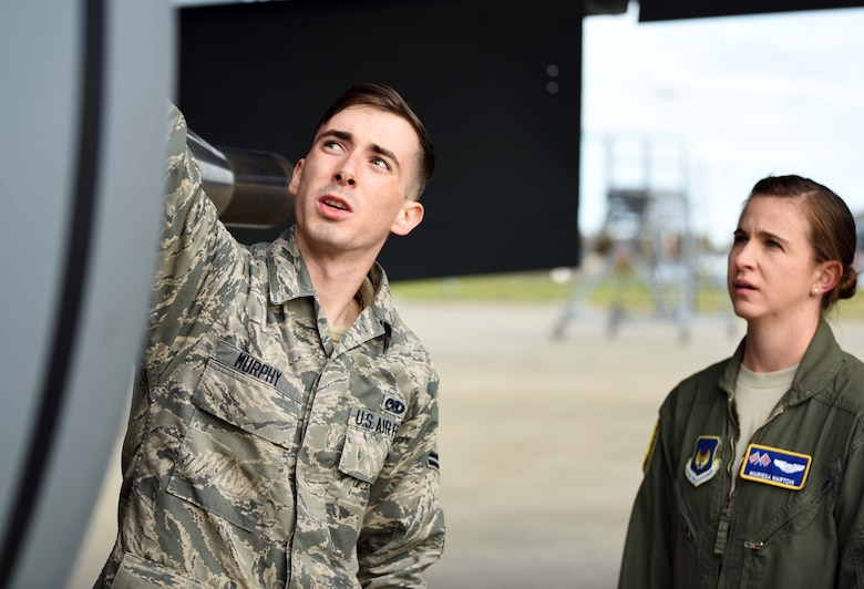 Airman 1st Class Cooper Murphy, 100th Aircraft Maintenance Squadron crew chief, briefs Capt. Marissa Hartoin, 351st Air Refueling Squadron aircraft commander, during a pre-flight check at RAF Mildenhall, England, July 23, 2020. The 351st ARS provides operational air refueling, aeromedical evacuation, airlift and rapid contingency response options for U.S. and NATO fighter, bomber and support and reconnaissance aircraft in the European and African theater of operations. (U.S. Air Force photo by Senior Airman Brandon Esau)