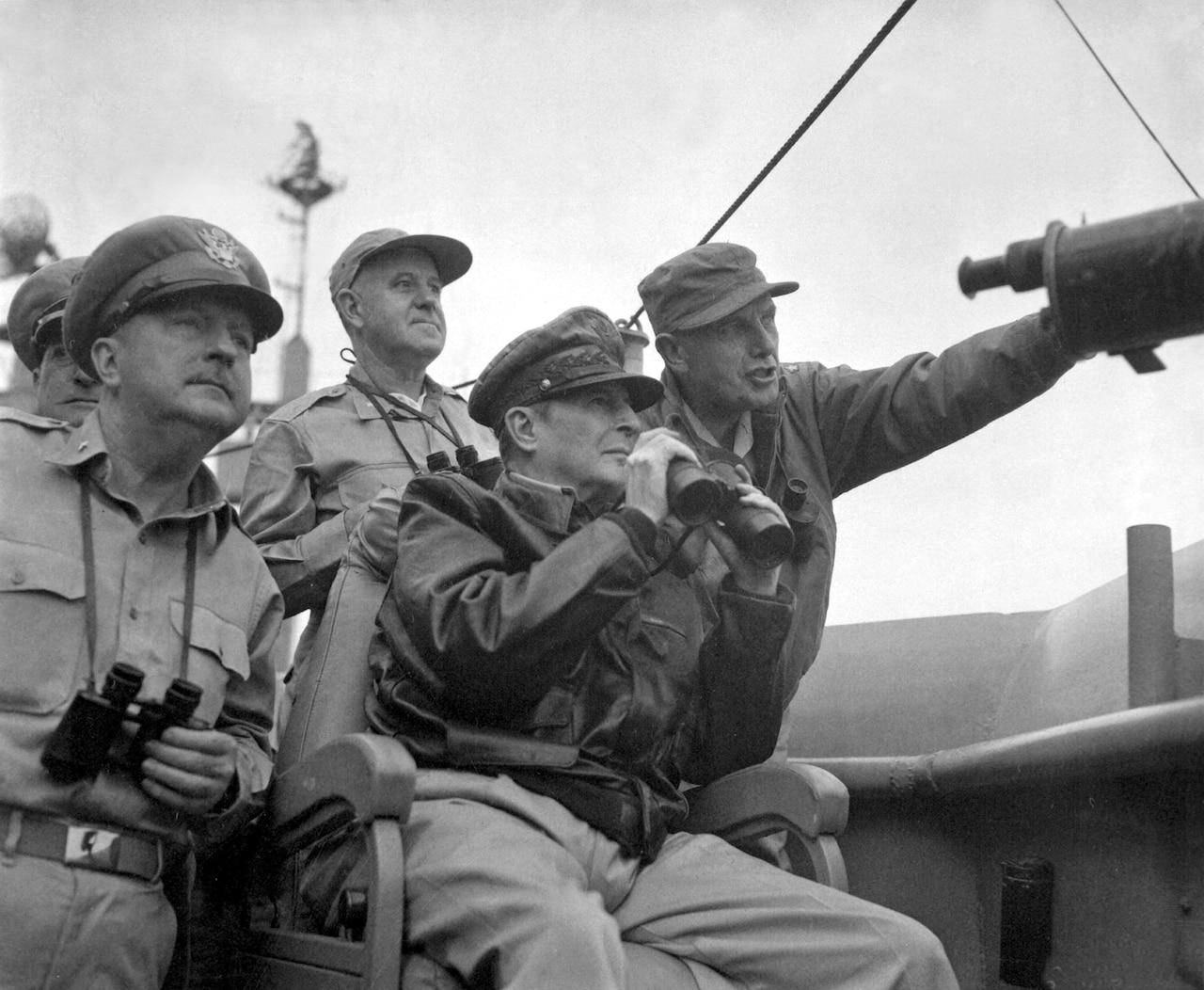 A general observes a battle.