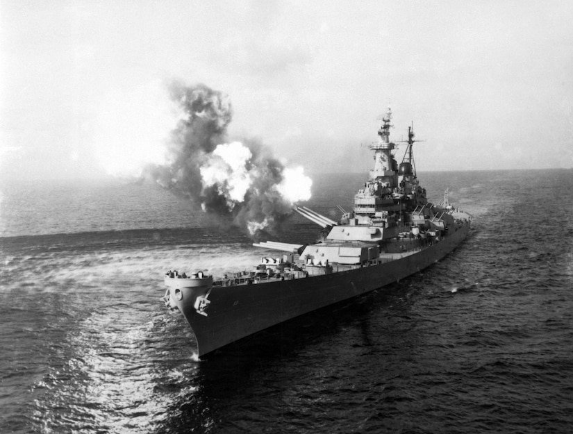 A battleship fires its weapons.