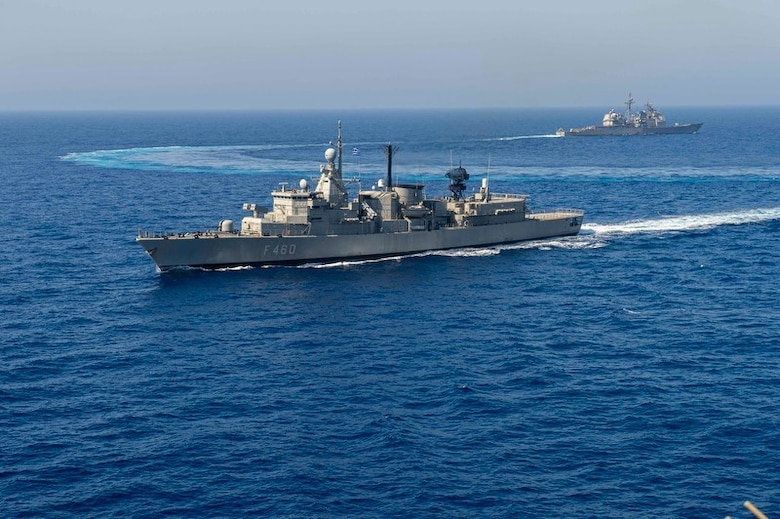 200726-N-KT825-1056 MEDITERRANEAN SEA (July 26, 2020) The Hellenic Navy frigate HN Aegean (FFGH 460), front, and the Ticonderoga- class guided-missile cruiser USS San Jacinto (CG 56) conduct joint operations with the Nimitz-class aircraft carrier USS Dwight D. Eisenhower (CVN 69) in the Mediterranean Sea, July 26, 2020. The Dwight D. Eisenhower Strike Group is conducting operations in U.S. 6th fleet area of operations in support of U.S. national security interests in Europe and Africa. (U.S. Navy photo by Mass Communication Specialist 3rd Class Sawyer Haskins)