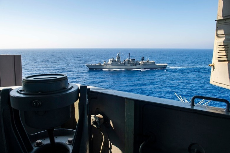 200726-N-KT825-1066 MEDITERRANEAN SEA (July 26, 2020) The Hellenic Navy frigate HN Aegean (FFGH 460) sails alongside the Nimitz-class aircraft carrier USS Dwight D. Eisenhower (CVN 69) in the Mediterranean Sea, July 26, 2020. The Dwight D. Eisenhower Strike Group is conducting operations in U.S. 6th fleet area of operations in support of U.S. national security interests in Europe and Africa. (U.S. Navy photo by Mass Communication Specialist 3rd Class Sawyer Haskins)