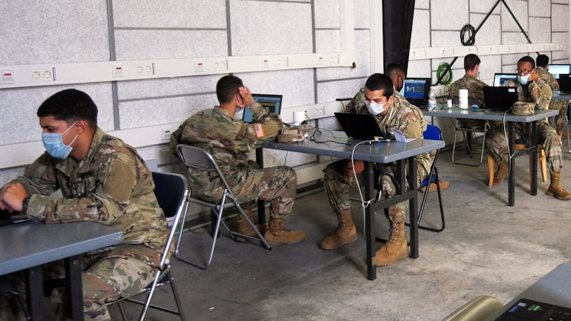 Inbound Soldiers from the United States to Europe, conduct virtual in-processing at the Deployment Processing Center on Rhine Ordnance Barracks in Kaiserslautern, Germany July 17, 2020. The DPC currently houses incoming personnel from the United States undergoing quarantine and in-processing to the European theater. Task Force Wilkommen is a group of organizations facilitating this process during the COVID-19 pandemic. (U.S. Army Reserve photo by Staff Sgt. Chris Jackson/Released)