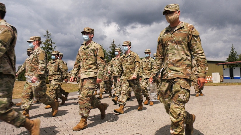 Soldiers, inbound from the United States to Europe, march to lunch at the Deployment Processing Center on Rhine Ordnance Barracks in Kaiserslautern, Germany July 17, 2020. The DPC currently houses incoming personnel from the United States undergoing quarantine and in-processing to the European theater. Task Force Wilkommen is a group of organizations facilitating this process during the COVID-19 pandemic. (U.S. Army Reserve photo by Staff Sgt. Chris Jackson/Released)