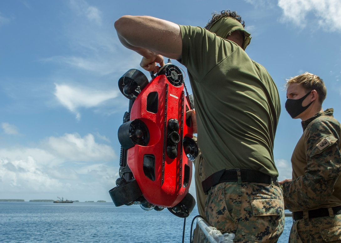 U.S. Marines remove a Strategic Robotics System Fusion Underwater Unmanned Vehicle out of the water during Littoral Explosive Ordnance Neutralization operations aboard the expeditionary Expeditionary Fast Transport (T-EPF 9) USNS City of Bismarck at sea, July 15.