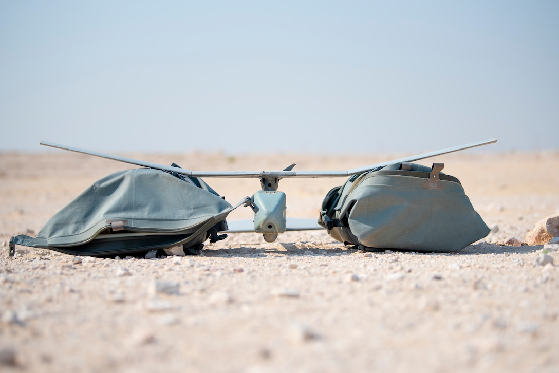 A Raven B Small Unmanned Aircraft System is preparing for flight training at Al Udeid Air Base, Qatar, July 9, 2020. The Raven B is a drone with full-spectrum capability that can be hand-launched from nearly anywhere on the installation at any time. Its primary mission at AUAB is force protection, however, the drone has been flown for real-world missions to include conducting airfield assessments and post-storm damage analysis. (U.S. Air Force photo by Senior Airman Ashley Perdue)