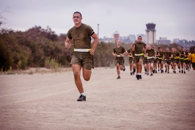 A recruit with Fox Company, 2nd Recruit Training Battalion, participates in a physical training session at Marine Corps Recruit Depot, San Diego, July 21, 2020.