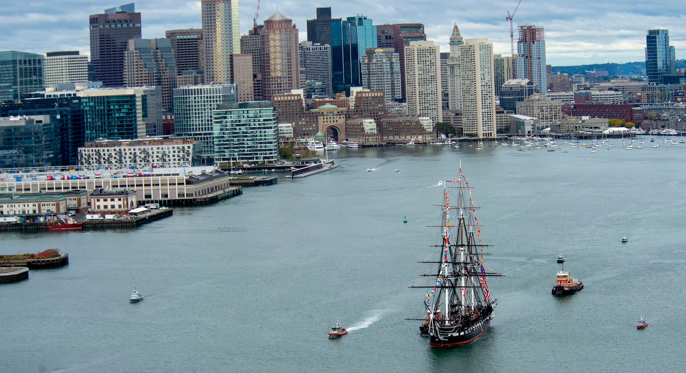 Top view of ship sailing through boston harbor
