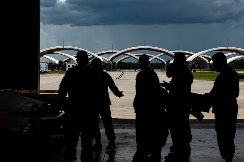 Photo of Airmen briefing the LATT.