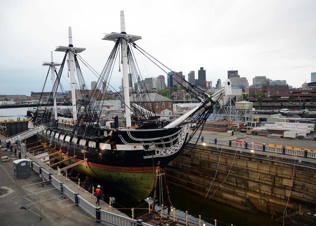 Constitution drydock for restoration with boston skyline in the background