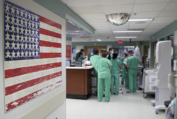 Brooke Army Medical Center nurses conduct a shift change briefing in a COVID-19 intensive care unit July 17.