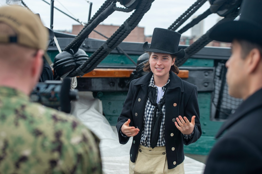 Photo captured Emma Hoernlein in her historic uniform, giving tour and explaining