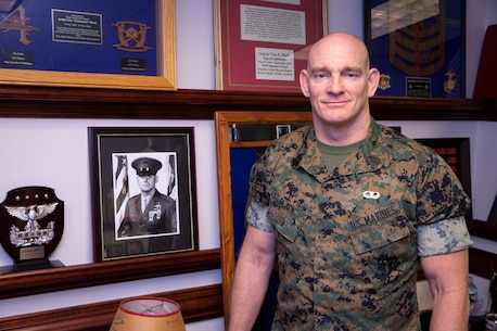 """The 19th Sergeant Major of the Marine Corps, Sgt. Maj. Troy E. Black poses for a photo with a photo of the 8th Sergeant Major of the Marine Corps, Sgt. Maj. John R. Massaro (retired) in Arlington, V.A., May 21, 2020. The office of the Sergeant Major of the Marine Corps recognized Sgt. Maj. Massaro as the oldest living Sergeant Major of the Marine Corps and as the gentleman who coined the term """"Ohrah"""". (U.S. Marine Corps photo by Sgt. Victoria Ross)"""