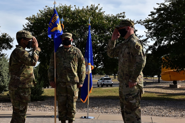 U.S. Air Force Lt. Col. Danny Dacey, 17th Healthcare Operations Squadron incoming commander, salutes Col. Lauren Byrd, 17th Medical Group commander, accepting command of the squadron at the 17th HCOS change of command ceremony in front of the Norma Brown Building on Goodfellow Air Force Base, Texas, July 27, 2020. Dacey took over command responsibilities of Lt. Col. Warren Conrow, who commanded the unit since its activation in August and previously the 17th Medical Support Squadron. (U.S. Air Force photo by Senior Airman Seraiah Wolf)