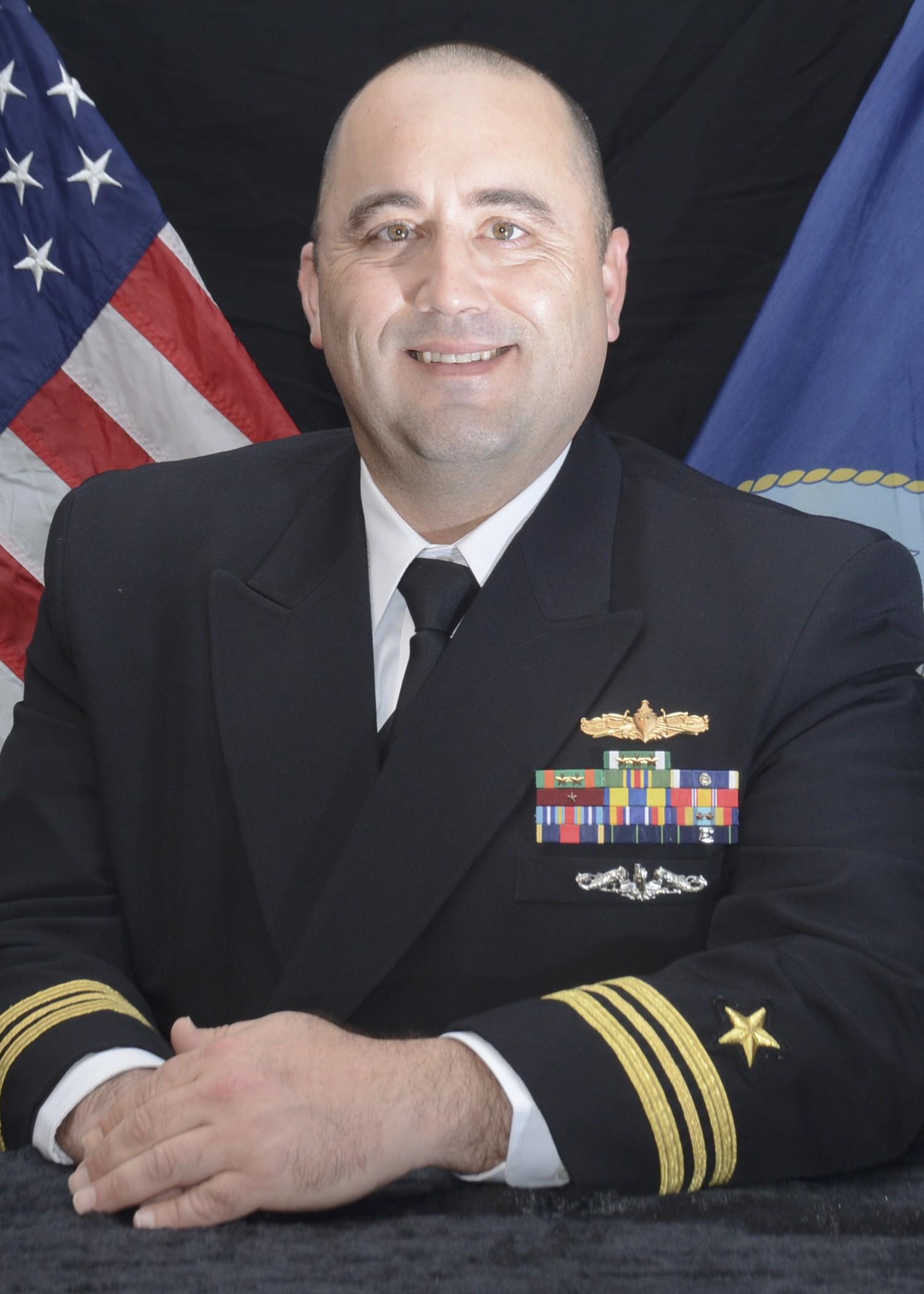 Portrait of LCDR Andrew Broyles in his navy uniform