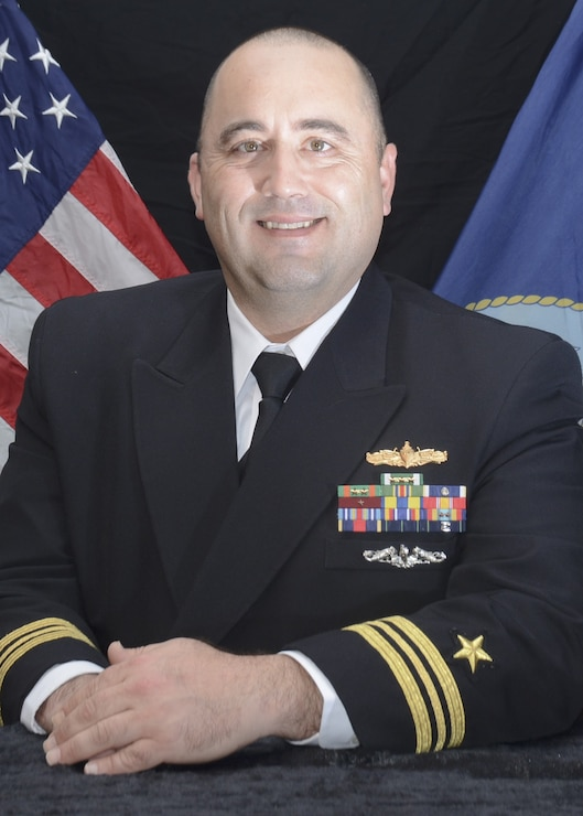 Portrait of LCDR Andrew Broyles in his navy uniform