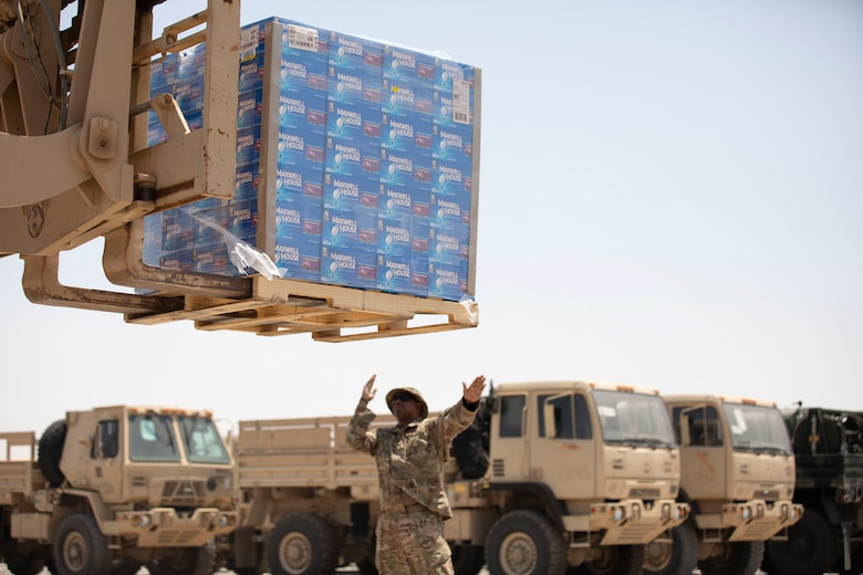 Grounded in giving: Chaplains transport donated coffee at Camp Arifjan