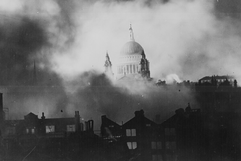Saint Paul's Cathedral in London is seen as the city burns around it .