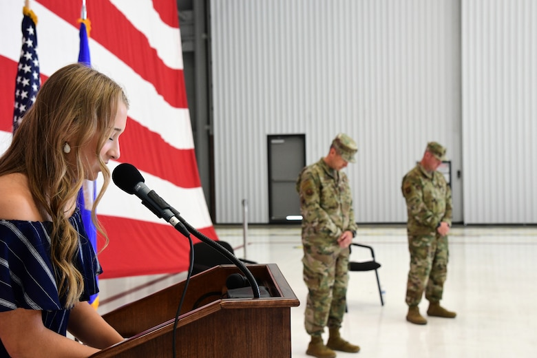 Emma Kirk gives the invocation for her father, Lt. Col. Michael Kirk, 926th Security Forces Squadron, Assumption of Command ceremony, July 24, 2020, Nellis Air Force Base, Nevada. The Assumption of Command ceremony was modified to honor heritage while maintaining current social distancing guidelines. (U.S. Air Force photo by Natalie Stanley)