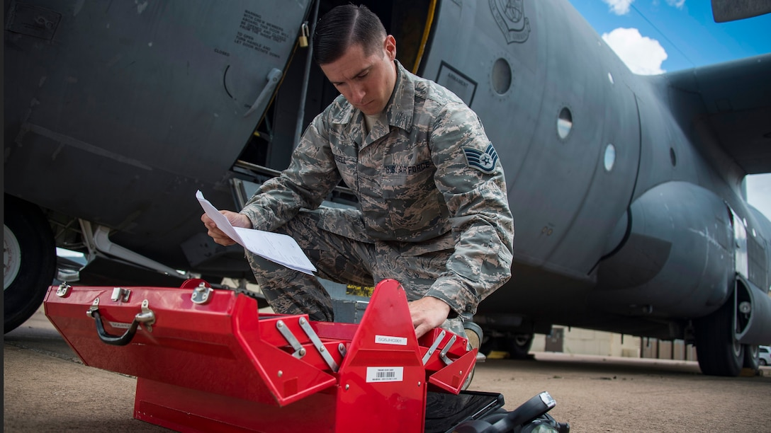 Staff Sgt. Wayne Russell takes inventory of a tool box