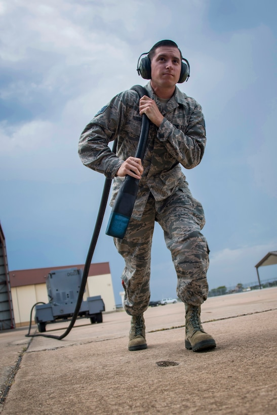 Staff Sgt. Wayne Russell pulls a power cable from a generator