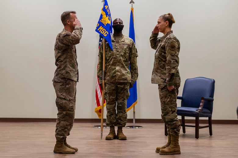 Col. Stephen Jones, 432nd Wing/432nd Air Expeditionary Wing, returns the salute of Col. Dina, 432nd Mission Support Group commander, as she assumes command of the 432nd MSG during  at Creech Air Force Base, Nevada, July 24, 2020.