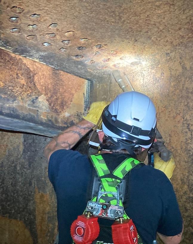 John Martin maintenance staff remove mineral and debris buildup from conduit air vents, June 2020.