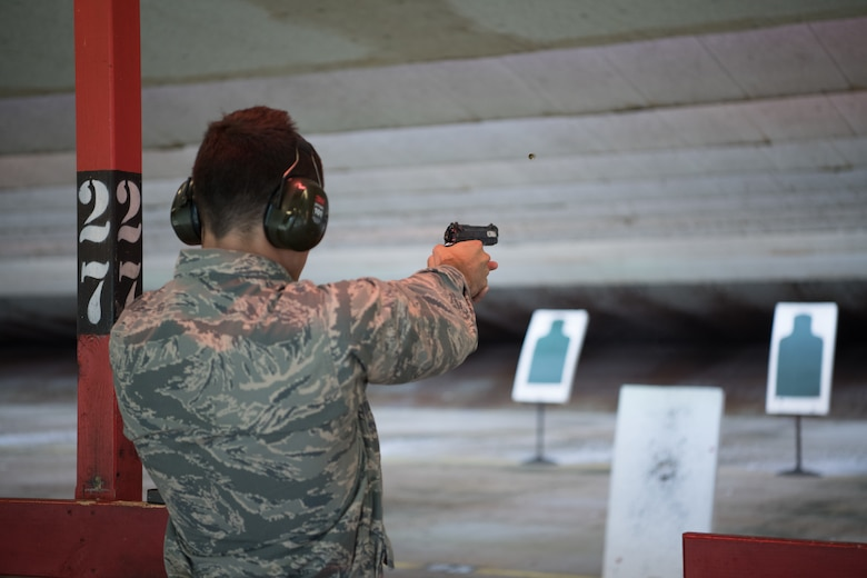 Air Force Reserve Officer Training Corps cadets take their paper targets off the stands.