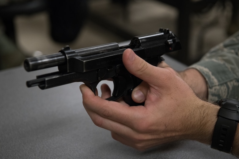 An Air Force Reserve Officer Training Corps cadet handles a Beretta M9 pistol during a class session July 9, 2020, at the Combat Arms Training and Maintenance facility on Maxwell Air Force Base, Alabama.