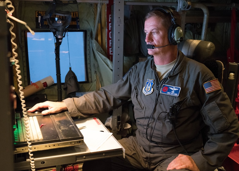 Chief Master Sgt. Rick Cumbo, loadmaster and dropsonde operator, reviews weather data collected during a weather reconnaissance mission into Hurricane Douglas July 24, 2020. Cumbo was part of the Air Force Reserve Hurricane Hunter aircrew who flew into the hurricane to collect data that assists forecasters in improving intensity and movement forecasts. The 53rd Weather Reconnaissance Squadron, assigned to the 403rd Wing at Keesler Air Force Base, Mississippi, departed July 22 to conduct operations out of Barbers Point Kapolie Airport, Hawaii. (U.S. Air Force photo by Lt. Col. Marnee A.C. Losurdo)