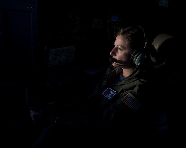Capt. Julie Fantaske, navigator for the 53rd Weather Reconnaissance Squadron at Keesler Air Force Base Miss., looks on as her pilot crew members steer through Hurricane Douglas from Barbers Point Kapolei, Hawaii, July 26, 2020. The 53rd WRS is part of the Air Force Reserve 403rd Wing and is the only unit of its kind in the entire Department of Defense. (U.S. Air Force Photo by Senior Airman Kristen Pittman)