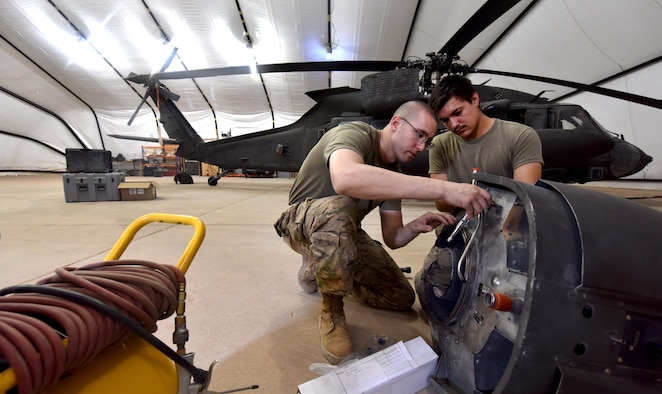 U.S. Army Soldiers from Task Force Javelin conduct maintenance on a UH-60 Blackhawk helicopter at Prince Sultan Air Base, Kingdom of Saudi Arabia