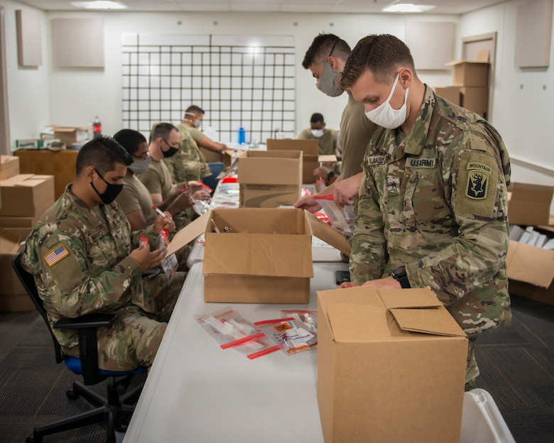 Soldiers from the 1-102nd Infantry Regiment assemble COVID-19 test kits at the Governor William A. O'Neill Hartford State Armory, Hartford, Connecticut, July 27, 2020.