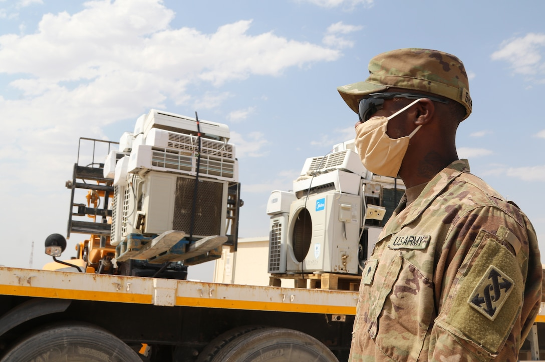 U.S. Army Spc. Eric S. Shepherd, 207th Regional Support Group services NCO, supervises the disposal of broken equipment at Al Asad Air Base, Iraq, July, 10, 2020. The Army Reserve unit provided life support services for three separate bases in Iraq through much of 2020 in support of Operation Inherent Resolve. Coalition Forces continue to work with allies and partners for a unified and determined mission to degrade and defeat Daesh. The unit is based in Fort Jackson, S.C. (U.S. Army photo by Sgt. 1st Class Gary A. Witte, 207th Regional Support Group)