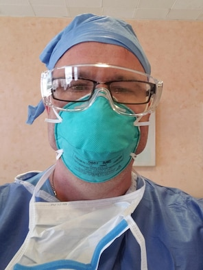 Maj. Leslie Shook takes a selfie in his medical personal protective equipment while working in Lincoln Medical Hospital in New York.