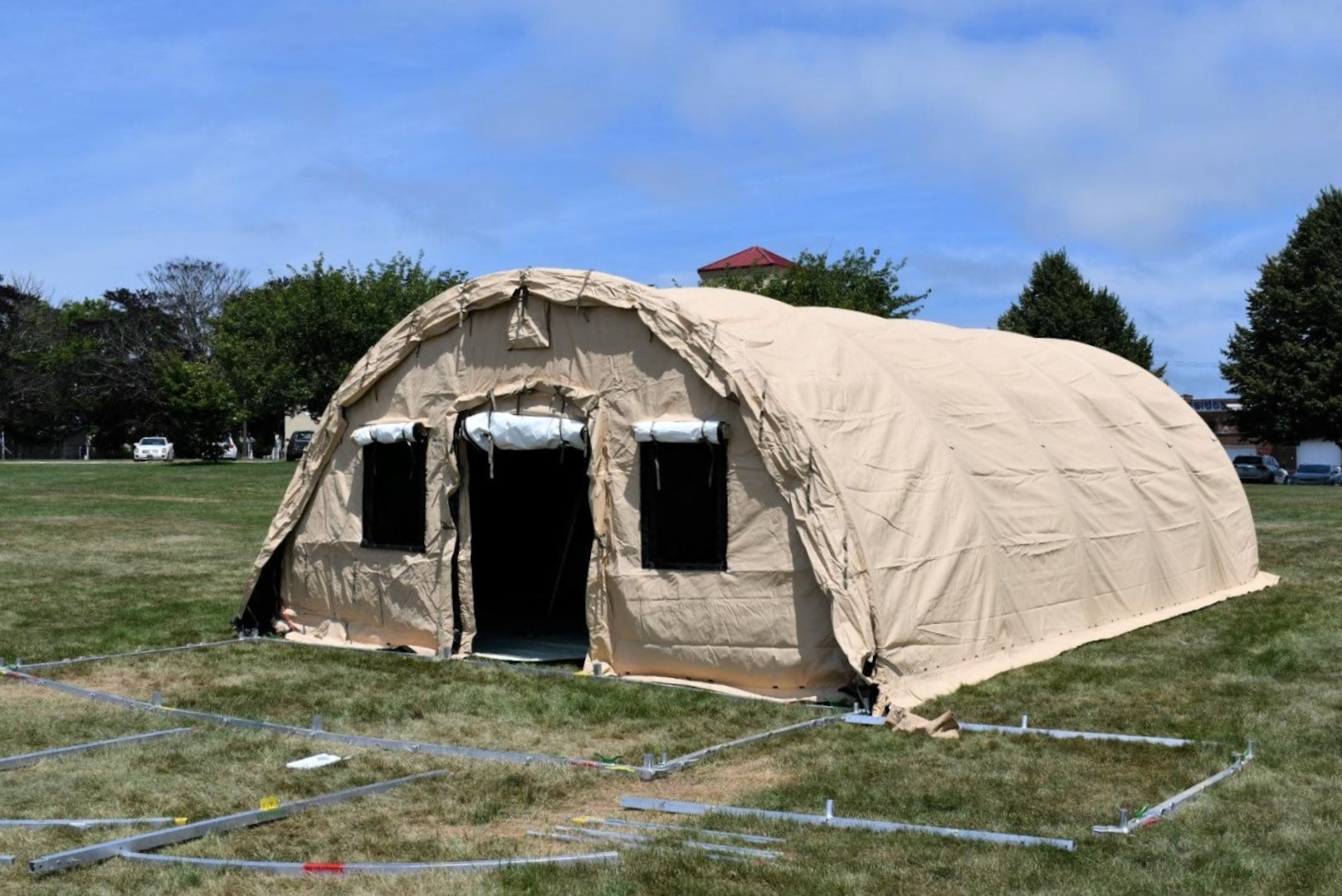 The first of five Alaska Medical Shelters awaits use after NMRTC employees raise the structure at the Navy's medical clinic in Newport, Rhode Island, on July 7, 2020. The Defense Logistics Agency partnered with Air Force and Navy medical to provide shelters for COVID-19 screening at naval medical facilities in the Northeast.