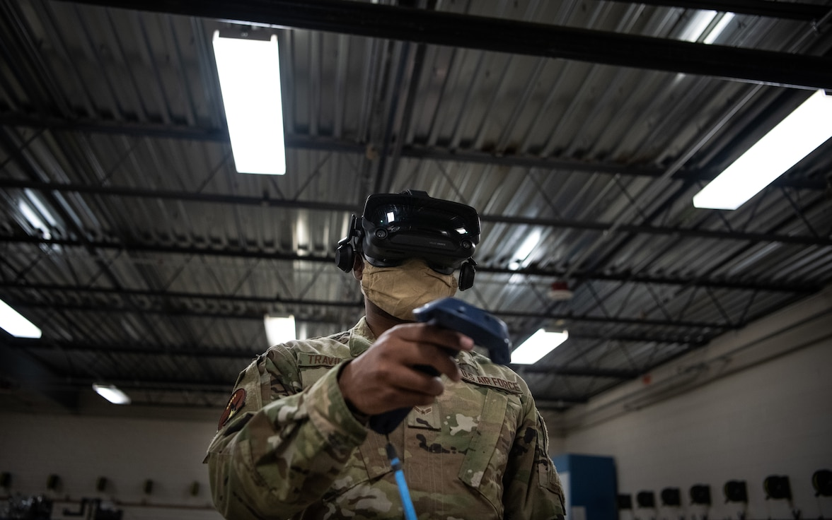 Airman 1st Class Delwyn Travillion, 56th Component Maintenance Squadron aircrew egress systems apprentice, trains on a virtual reality maintenance trainer July 13, 2020, at Luke Air Force Base, Ariz. The Egress Systems Flight implemented the virtual reality maintenance trainer to enhance training efficiency and reduce training time. The 56th Fighter Wing's mission is to train the world's greatest fighter pilots and combat ready Airmen. (U.S. Air Force photo by Airman 1st Class Dominic Tyler)