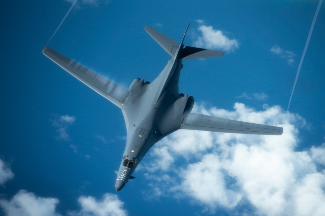 A 28th Bomb Wing B-1B Lancer, from Ellsworth Air Force Base, S.D., conducts aerial refueling with a 909th Aerial Refueling Squadron KC-135 Stratotanker, from Kadena Air Base, Japan, during a Bomber Task Force (BTF) mission July 27, 2020. The BTF missions are intended to demonstrate U.S. commitment to the collective defense of the U.S. Indo-Pacific Command theater and are a visible demonstration of the U.S. capability of extended deterrence. (U.S. Air Force photo by Staff Sgt. Peter Reft)