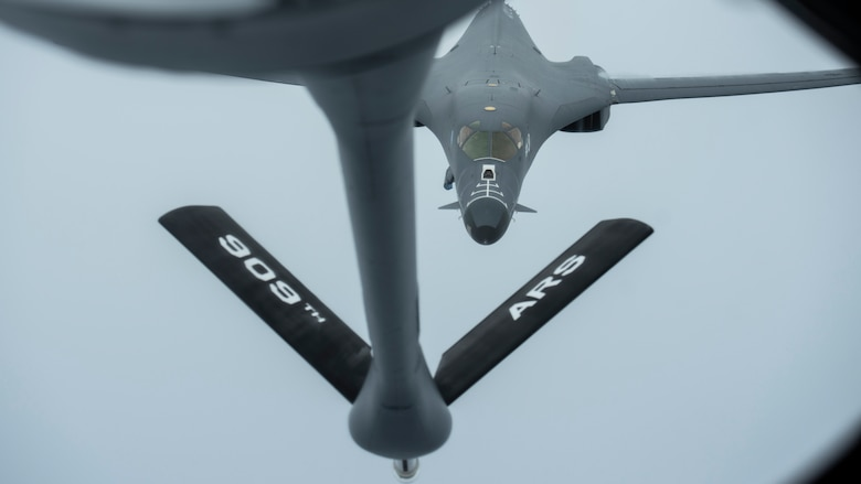A 28th Bomber Wing B-1B Lancer, from Ellsworth Air Force Base, S.D., conducts aerial refueling with a 909th Aerial Refueling Squadron KC-135 Stratotanker, from Kadena Air Base, Japan, during a Bomber Task Force (BTF) mission, July 27, 2020. The BTF supports the U.S. Air Force's dynamic force employment model in line with the National Defense Strategy's objectives of strategic predictability with persistent bomber presence. (U.S. Air Force photo by Staff Sgt. Peter Reft)