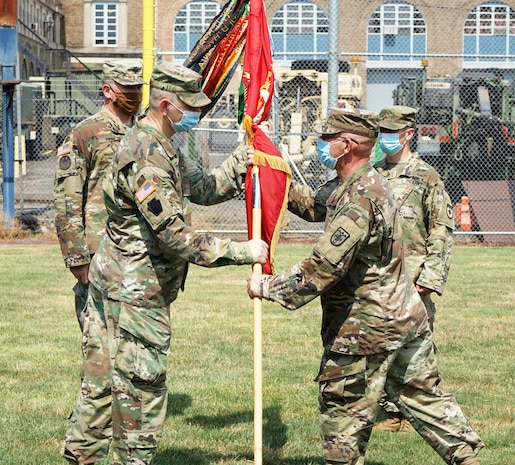 (Left to Right) Lt. Col. William G. Start, outgoing commander of the 1st Battalion, 109th Field Artillery Regiment, is handed the battalion colors from Command Sgt. Maj. Jerry Ressler, battalion command sergeant major, during the 1/109th FA change of command ceremony on July 19, 2020. During the ceremony, Start passed the battalion colors to Col. John Pippy, commander of the 55th Maneuver Enhancement Brigade, who then passed the colors to the incoming commander, Maj. Michael Tornambe. (U.S. Army photo by Sgt. 1st Class Matthew Keeler)