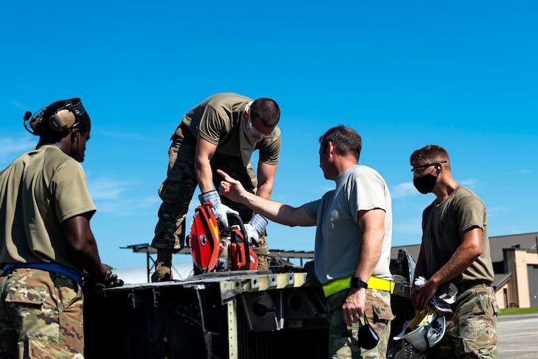Photo of Airmen conducting crash recovery training.