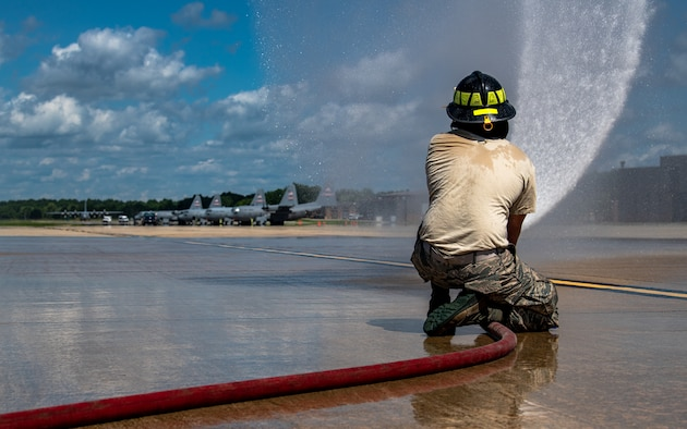 Firefighters assigned to the 910th Fire Department discuss training procedures, July 24, 2020, on the flightline at Youngstown Air Reserve Station. Airmen from the FD were completing Seasonal Training requirements for pump operations. ST is a program where Airmen raise their skill level from apprentice to a journeyman.