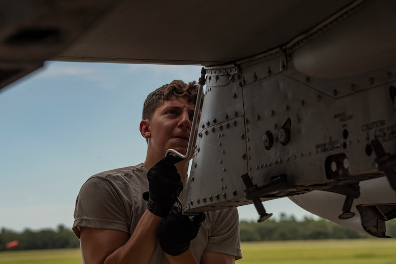 A photo of an Airman performing maintenance