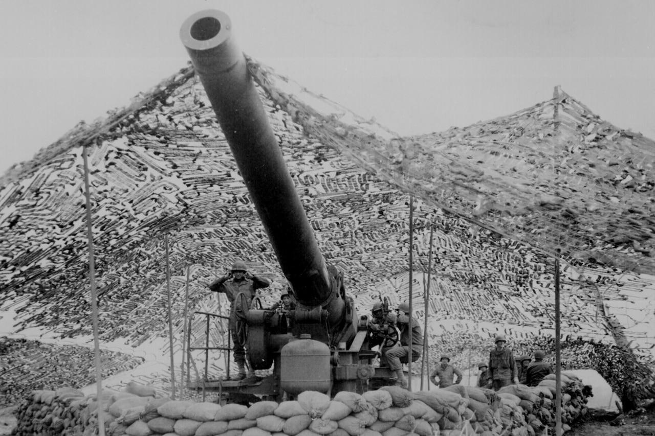 A large gun prepares to fire.